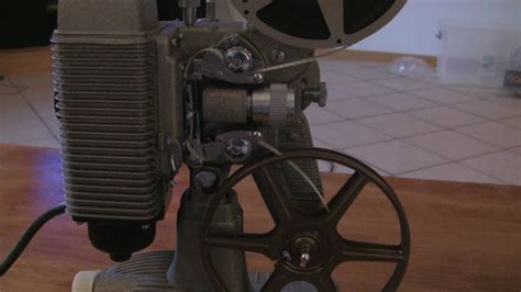 Loading and Rewinding an 8mm Projector (Revere 85) - YouTube