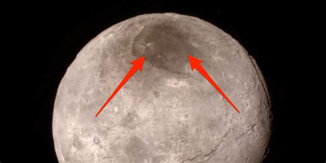 Why Pluto's largest moon Charon has a big red spot